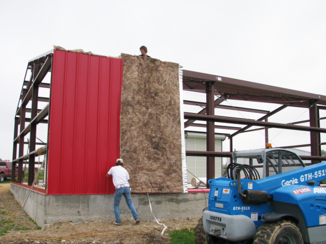 Putting up the insulation and the exterior metal walls.