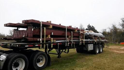 Metal framing material being delivered.