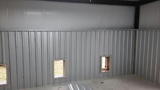 Inside the Bad Ass metal kennel where the inside kennels will be.