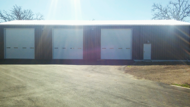 All custom auto and motorcycle shop with mezzanine.  Front of the building with custom lights.
