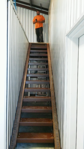 The custom designed metal stairs to the mezzanine.