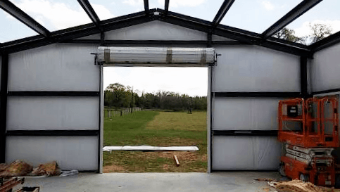 One end with insulation and a roll up door.