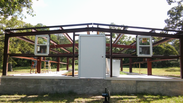 `Door and windows, and ready for the insulation and walls.
