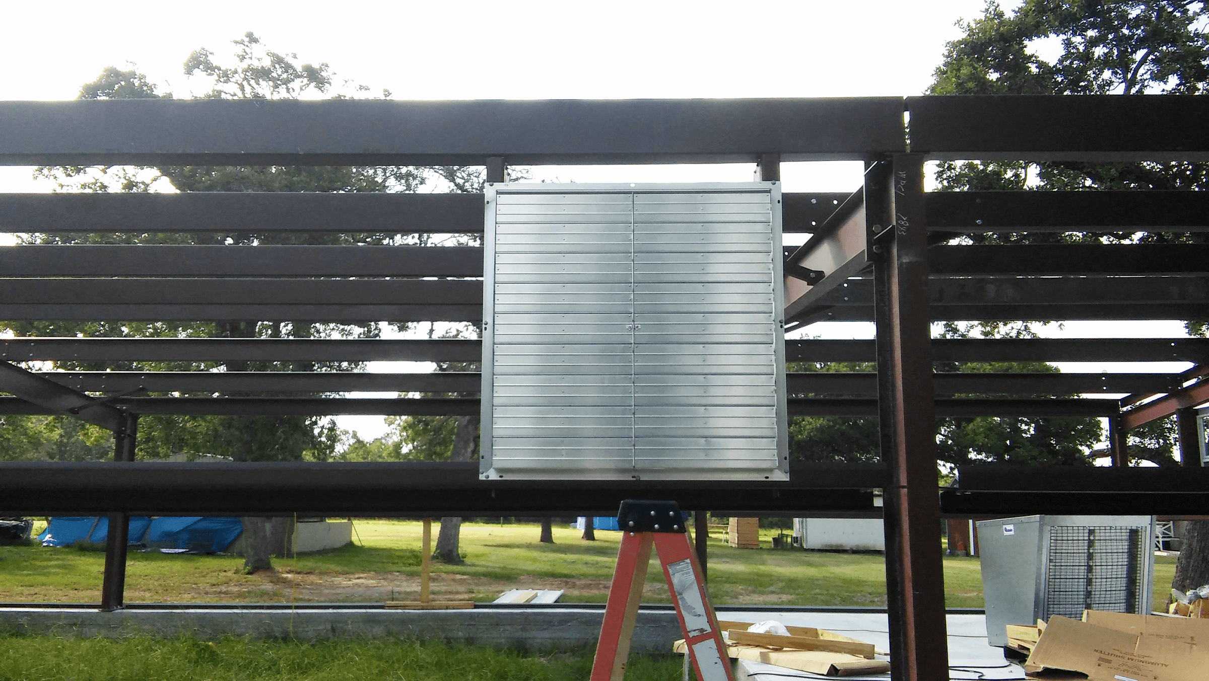 Installation of the exhaust fan to keep the rabbits cool.