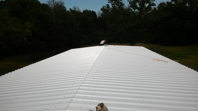 Getting the metal roof installed.