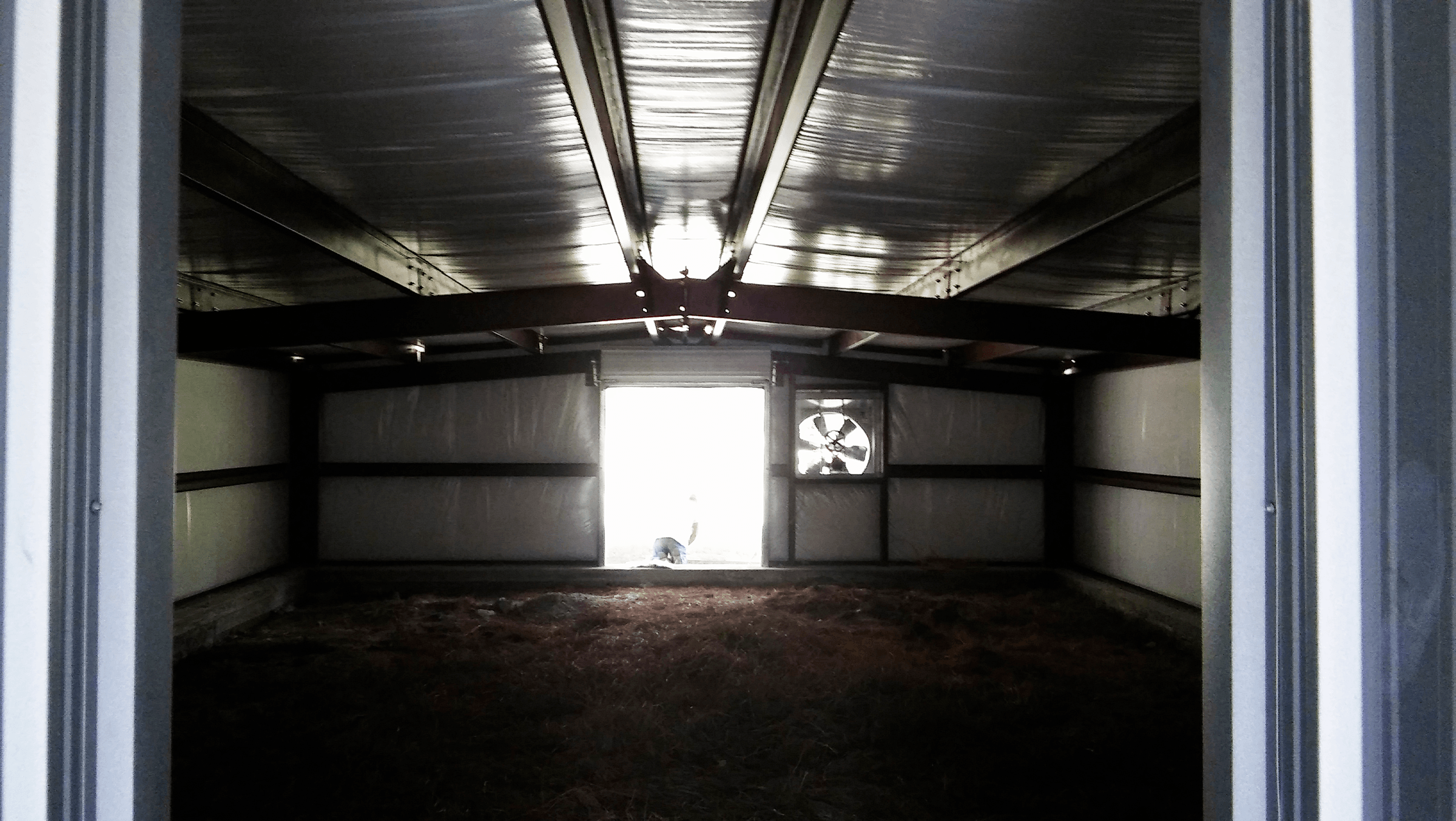 Although it's dark, this is the view of the back part of the building showing the double doors and large exhaust fan.