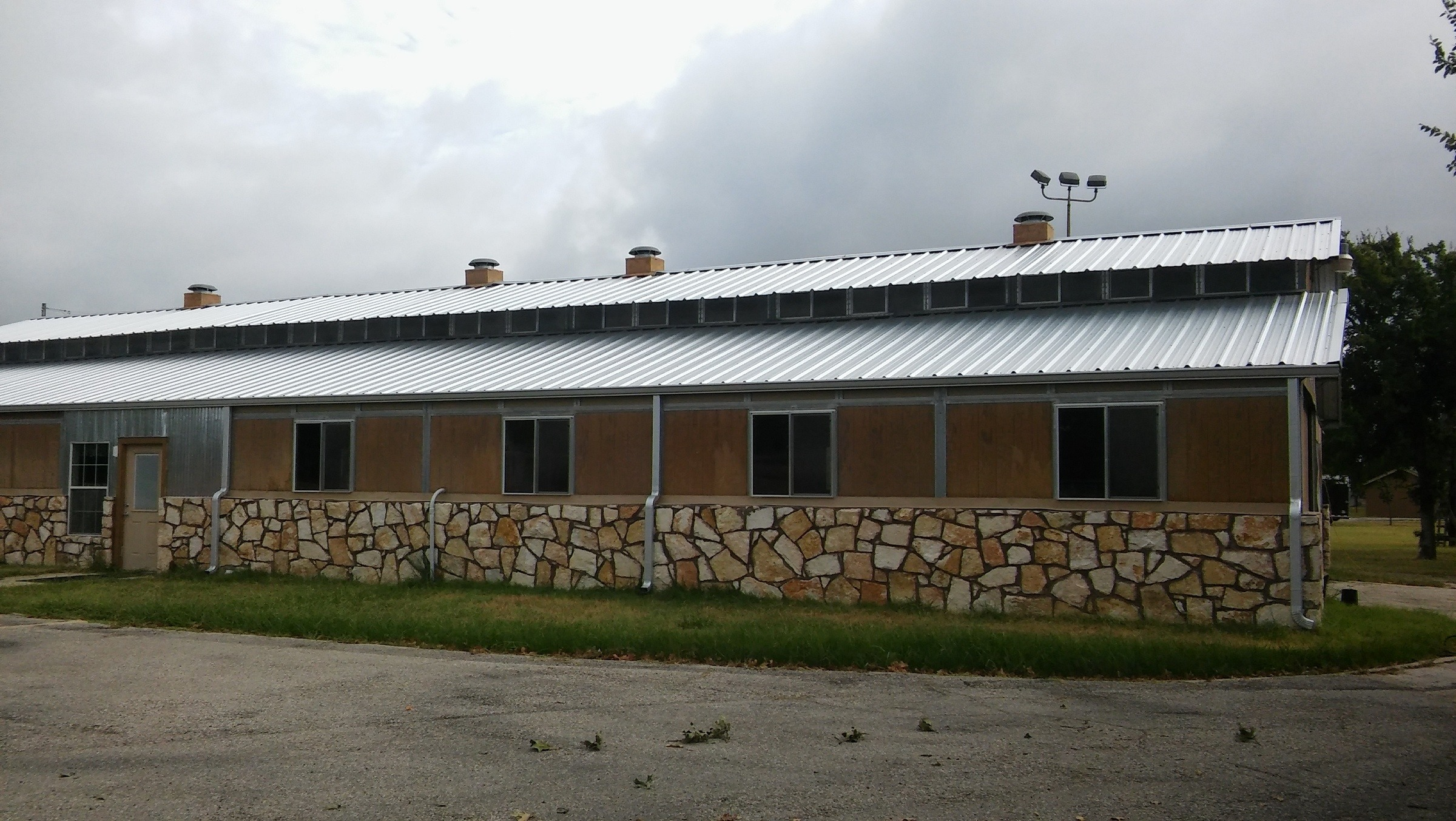 Side view of the metal barn prior to refurbishment.