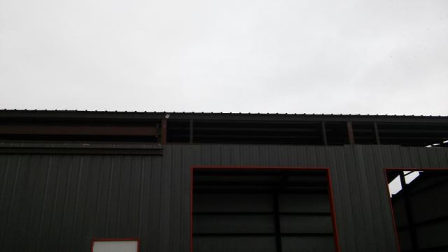 Metal roof is on.