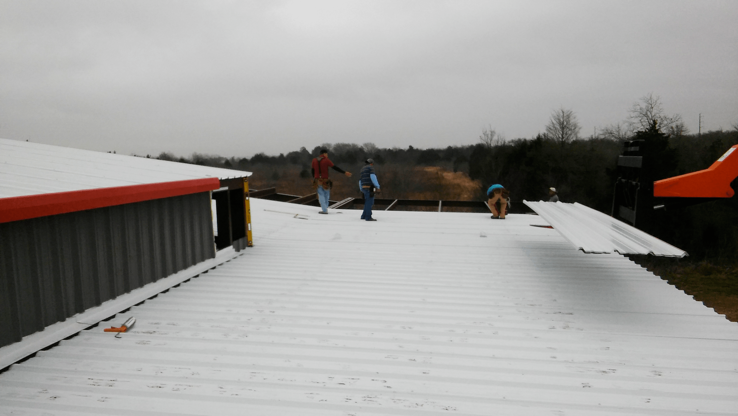 Overhang roofing going on.