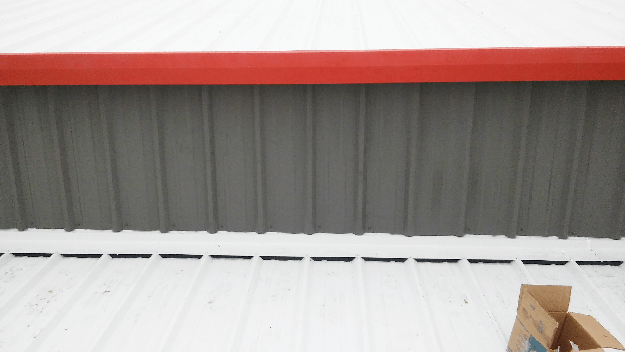 Red trim to keep the roof weather tight.
