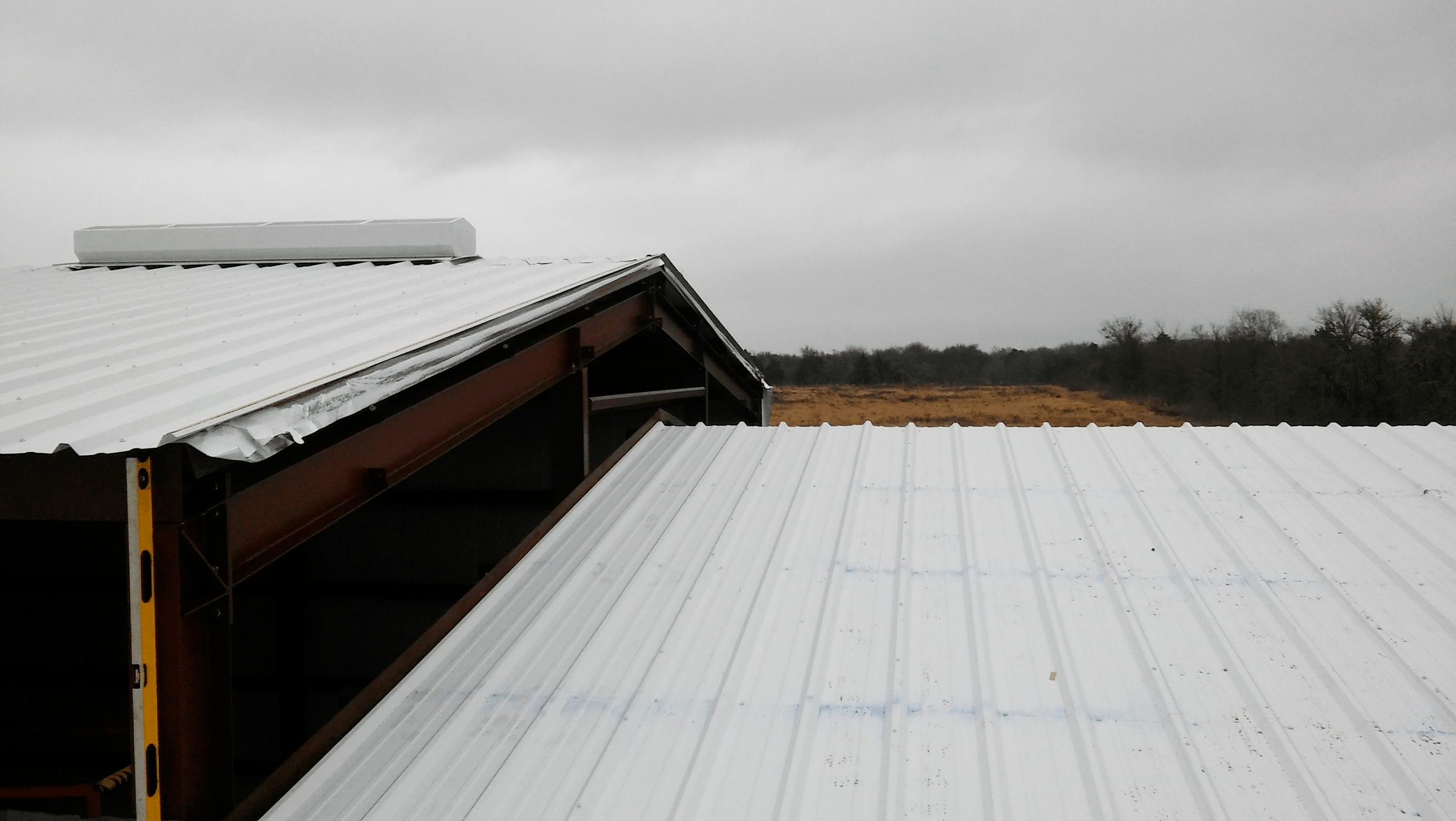 Wash bay roofing going on.