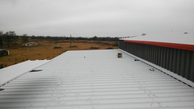 Putting the finishing touches on the barndominium and overhang.