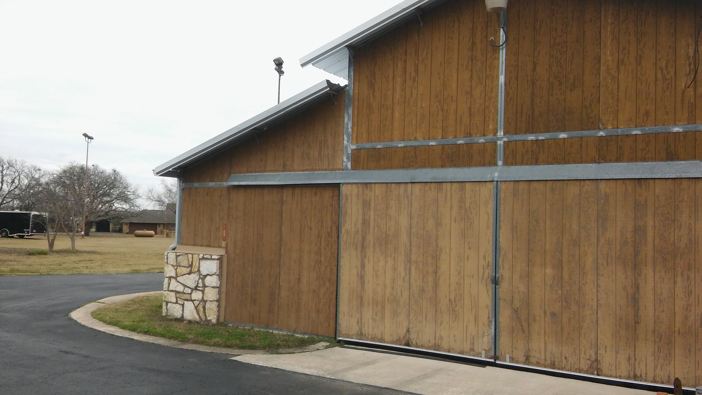 Sliding doors prior to metal barn refurbishment.