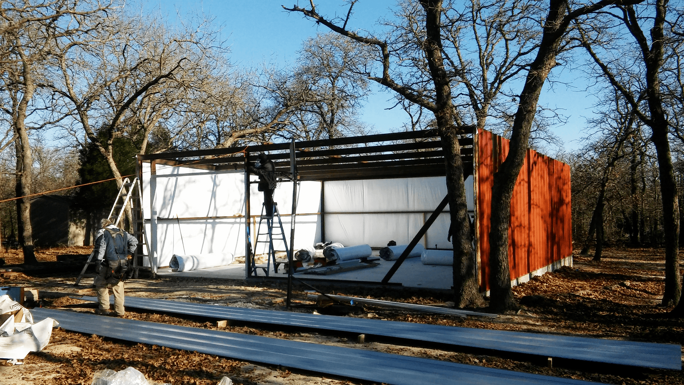 Insulation and side walls are up on the steel building.