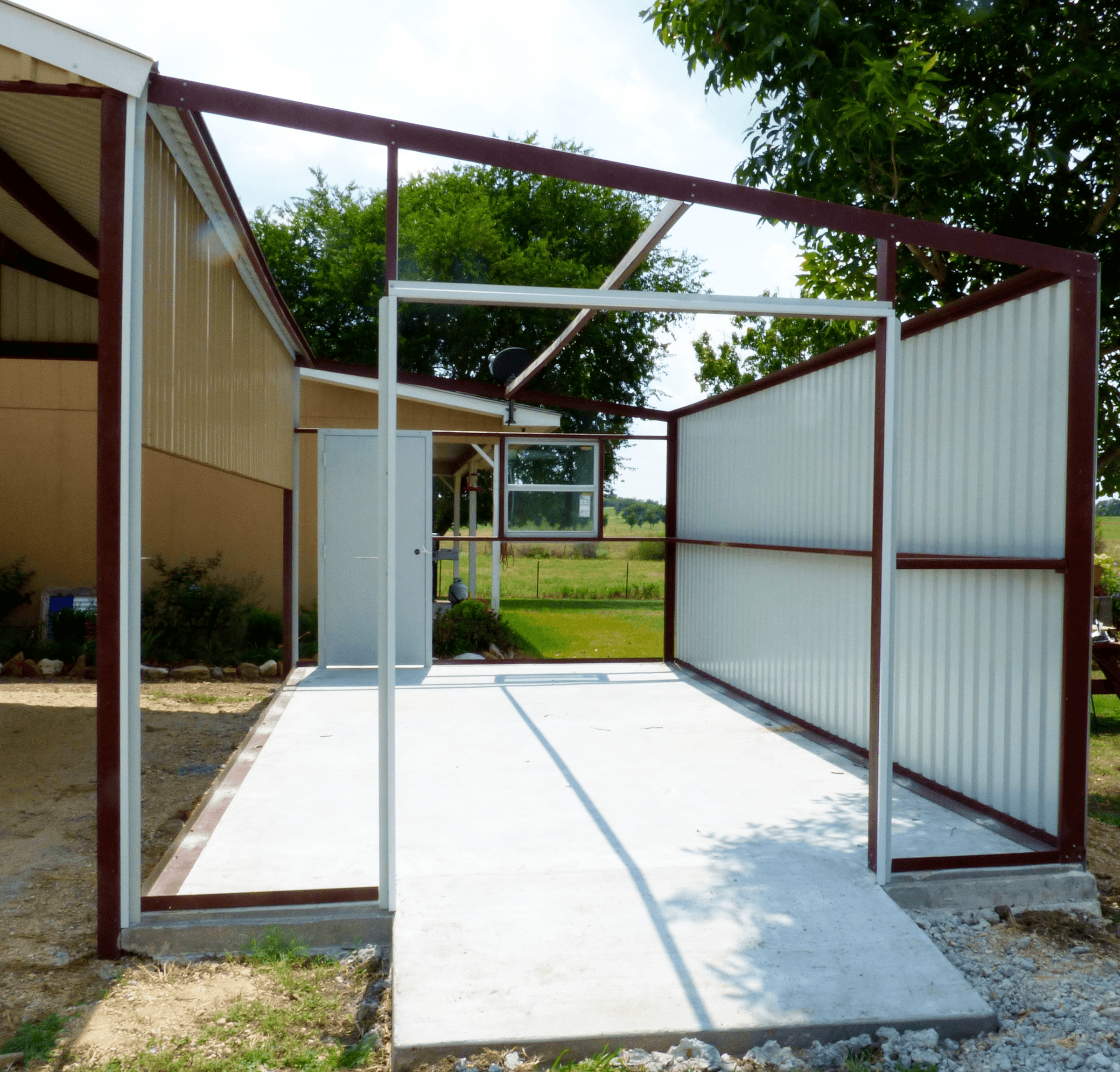 We poured a concrete pad and connected this building to the existing carport.