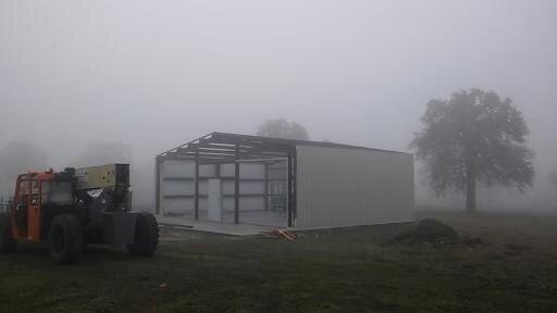 Metal sides and roof framing from the front.  metal garage