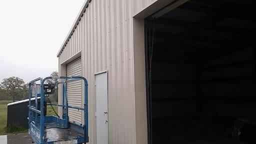 Front of metal garage showing detail of metal trim package on doors.