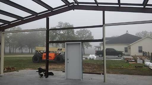 View from inside the metal garage looking out the front.