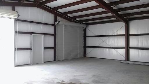 This shows the insulation, roll doors, and walk-through door in the metal garage.
