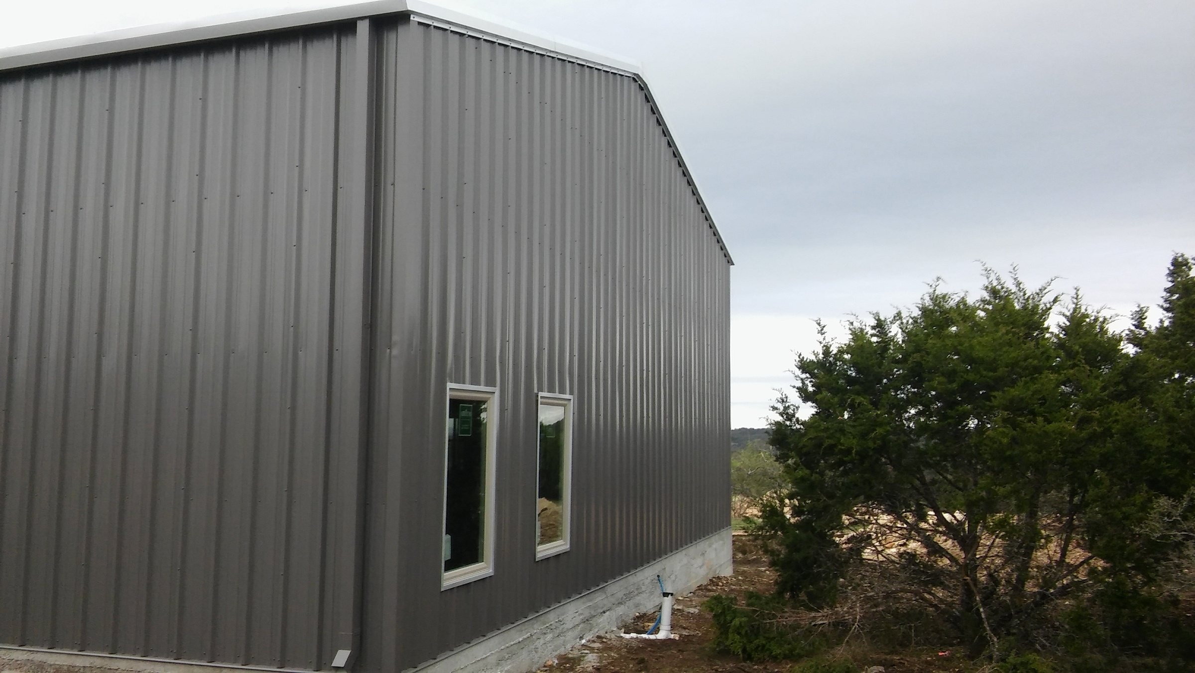 Metal siding on house end.