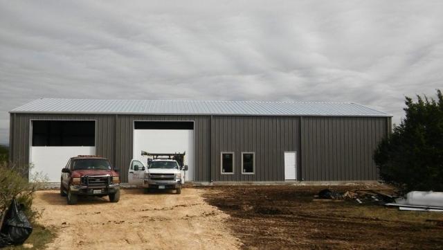 Custom metal barndominium with two garages.