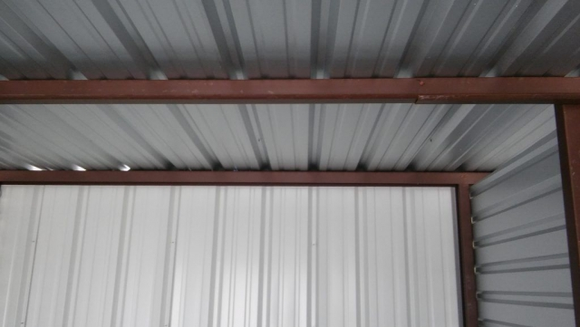 Detail of the metal framing inside one of the storage units.