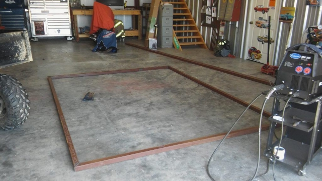 Custom designed and fabricated door for the metal building at Baker Sanctuary being started at the home shop of Simply Metal Structures, LLC.  metal door, custom designed