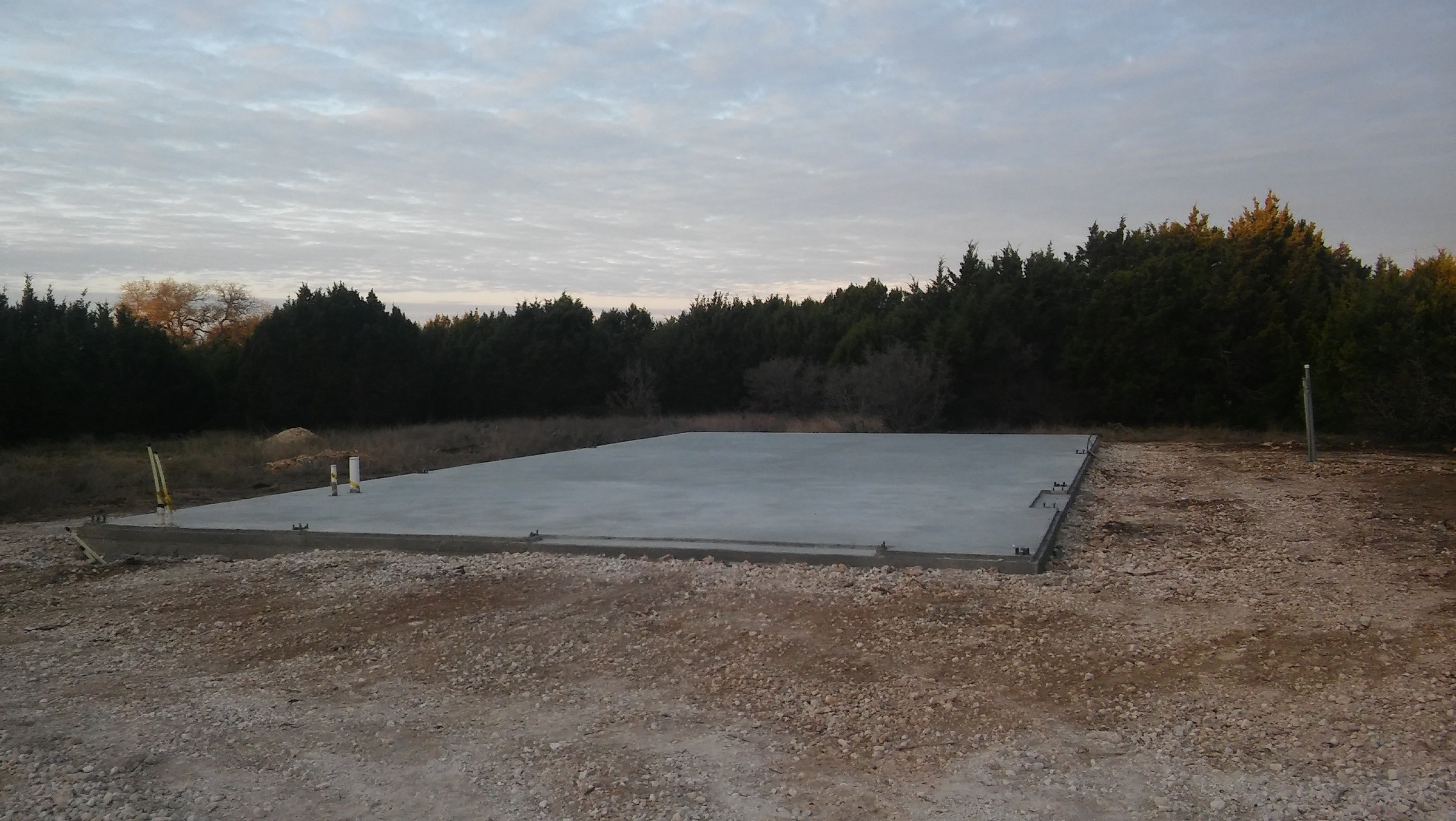 The concrete pad for the steel building.