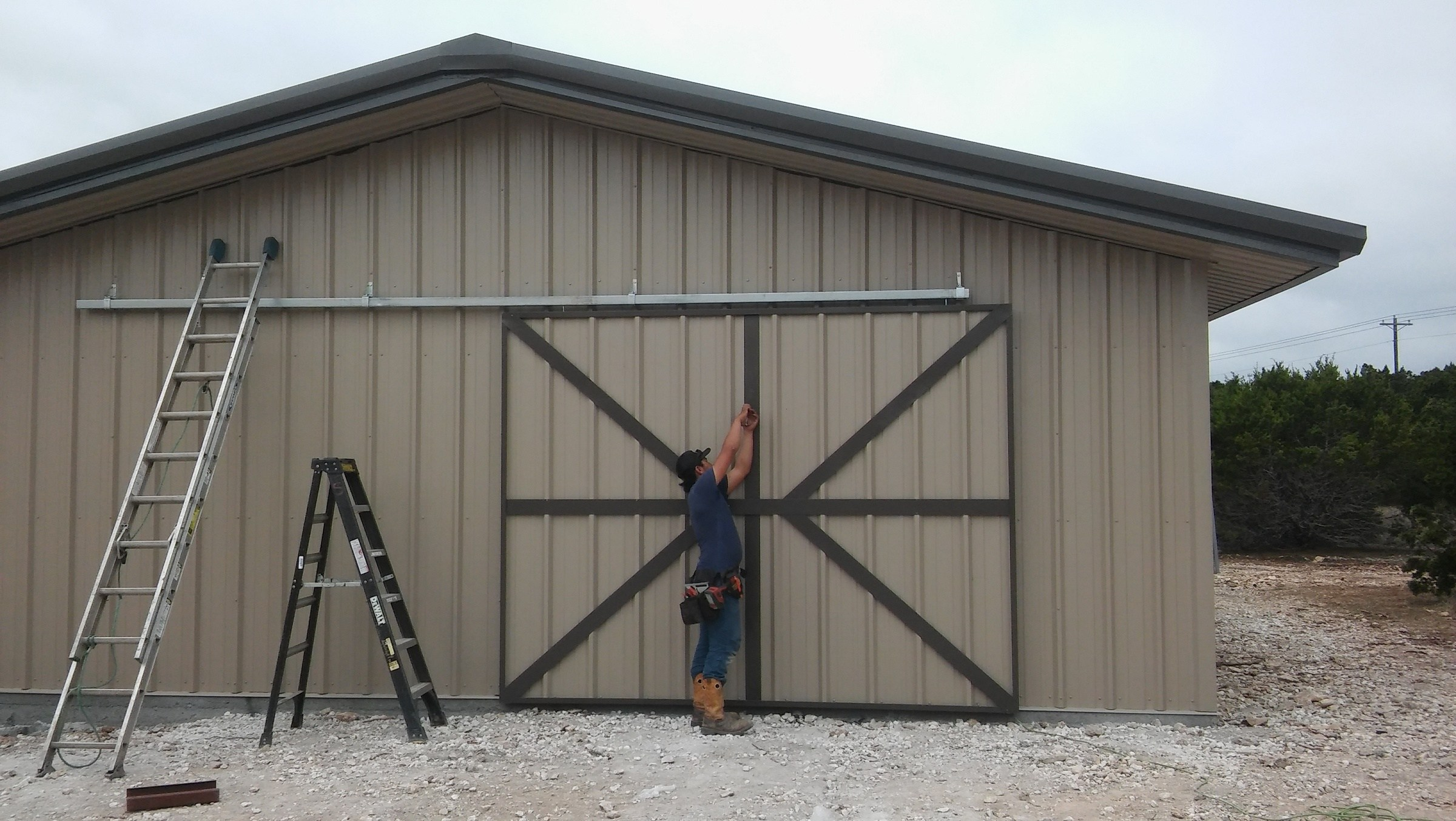 Custom designed metal door fabricated by Eric for the metal building at Baker Sanctuary, Travis Audubon.  metal door, custom designed