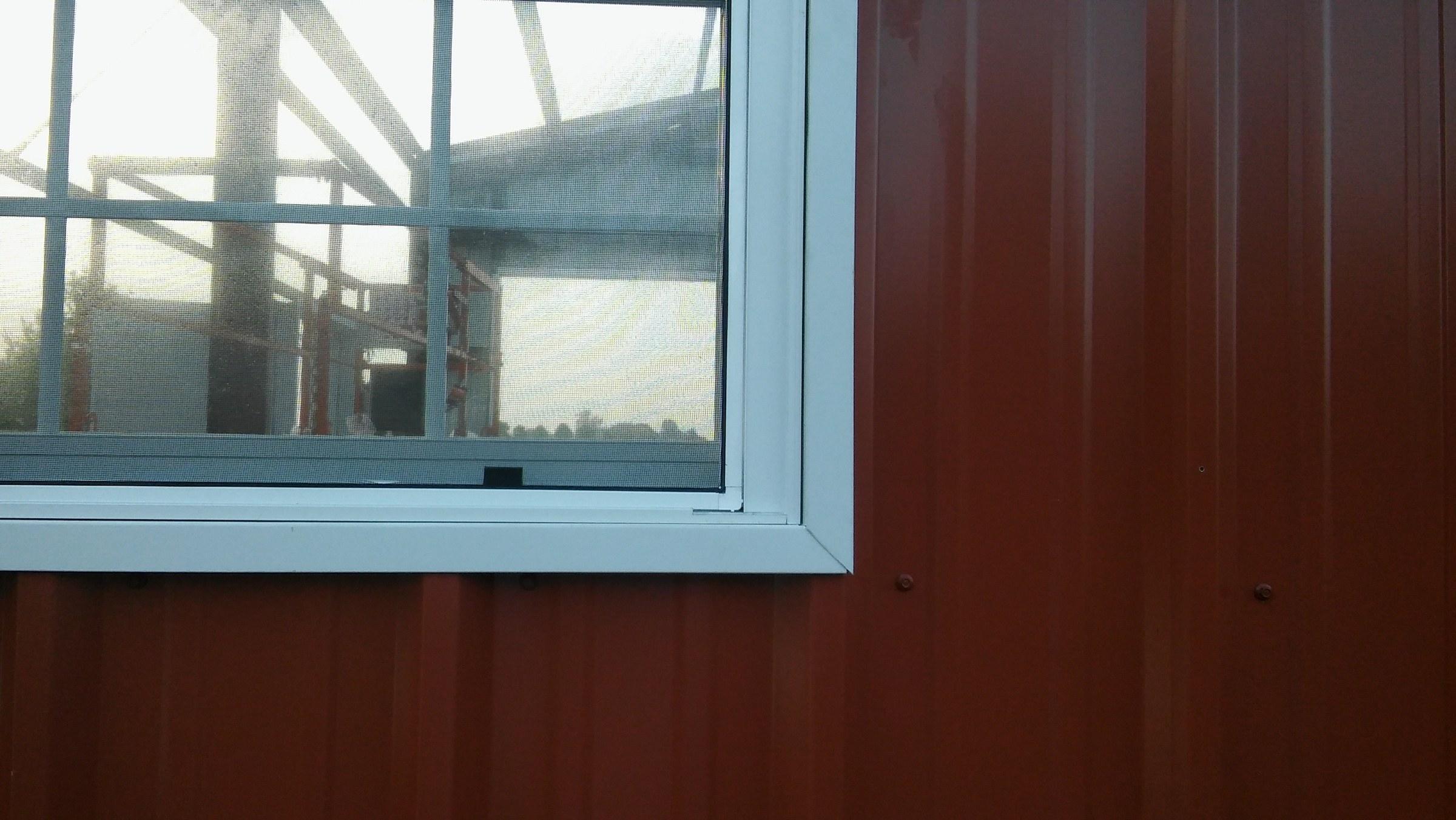 Detail on upgraded windows for custom metal shop.